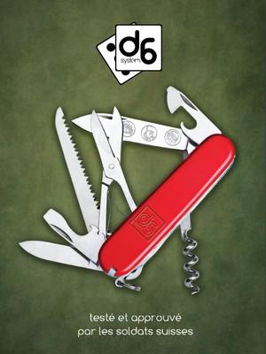 """Couverture du livre de base D6 Système. La couverture présente un couteau suisse ouverte sur de multiples options et est sous-titrée """"testée et approuvée par les soldats suisses"""""""